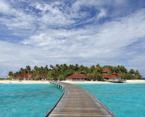 Le Maldive in barca atollo